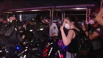 NYPD officers arrest protesters for defying citywide curfew