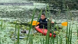 New Jersey police officer in kayak rescues dog trapped in muddy pond, video shows