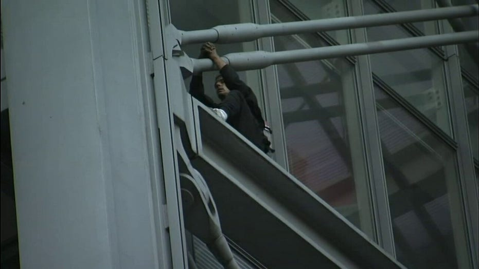 New York Times building climber halted on fifth floor, video shows