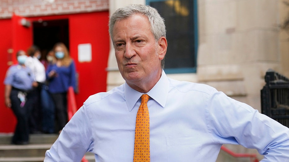 Homeless advocates protest Mayor Bill de Blasio's plan to move homeless out of hotels