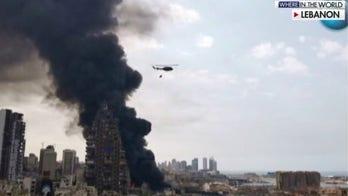 Beirut port ablaze; fires burn through Europe's largest refugee camp