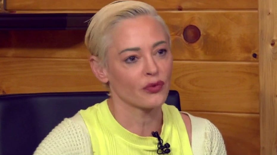 Rose McGowan says Weinstein tapped her home, tried to drive her off the road to silence her ahead of memoir