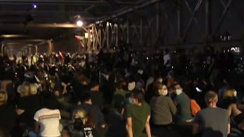 Protesters take the streets for a third night after the decision in Breonna Taylor case