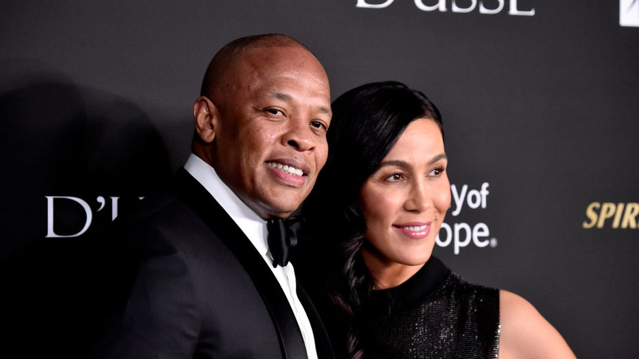 Dr. Dre's ex-wife avoids question about serving him divorce papers at his grandmother's burial