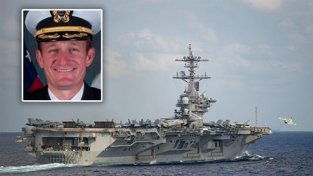 Navy men and women applaud ousted carrier commander as he exits ship