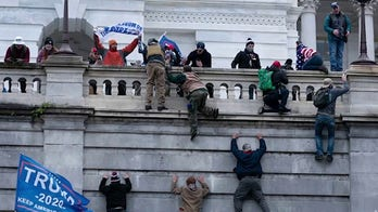 Lawmakers forced to hide as rioters storm into Capitol building