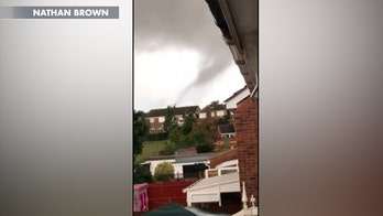 Suspected rare tornado in England whirls across town