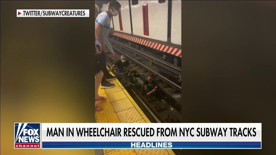 Man in wheelchair rescued from New York City subway tracks