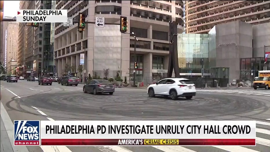 Street racers in Philadelphia filmed doing donuts around cop car outside City Hall, no arrests made
