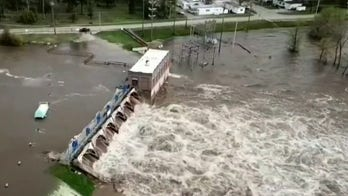 Swollen Michigan river crests as Whitmer, officials warn flood danger isn't over yet