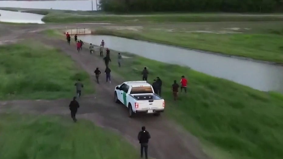 Fox News spots migrant group running across southern border into US
