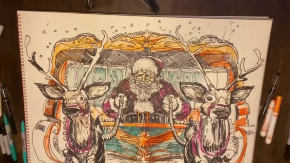 Artist Charlie Snogans finishes drawing of patriotic Santa Claus