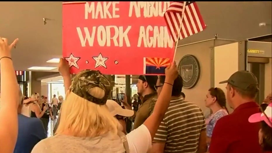 Protests over stay-at-home orders extend to more states