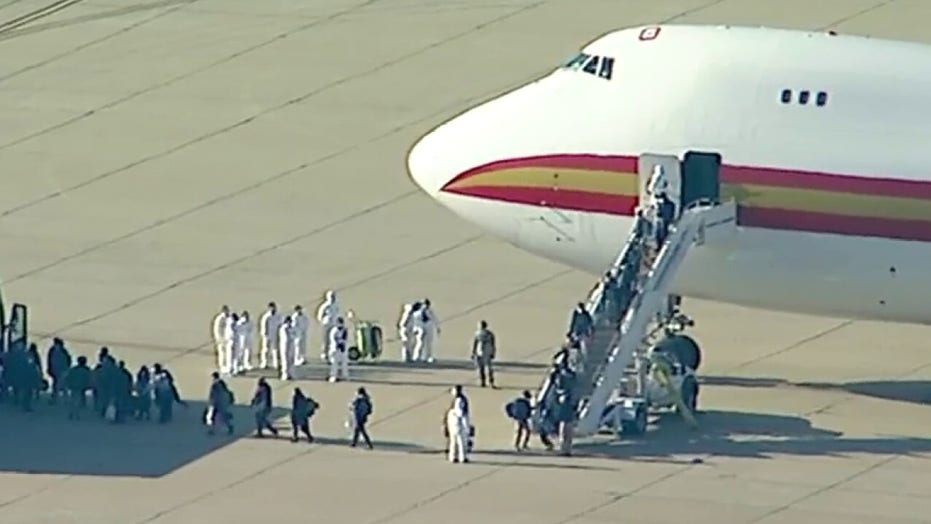 Evacuated Americans deplane from chartered flight from Chinese epicenter of coronavirus outbreak