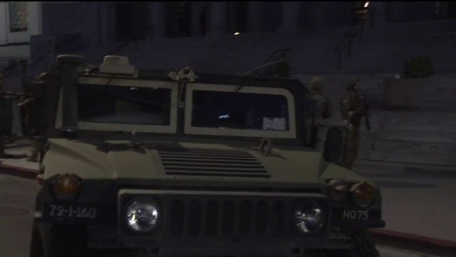 National Guard vehicles stage outside City Hall in Los Angeles