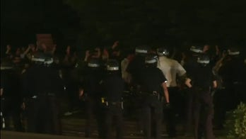 New York City police work to enforce curfew, maintain order