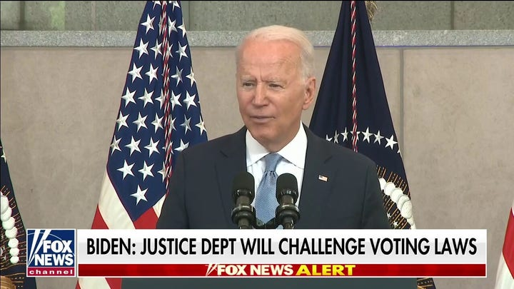 Biden doubles down in fight over voting laws