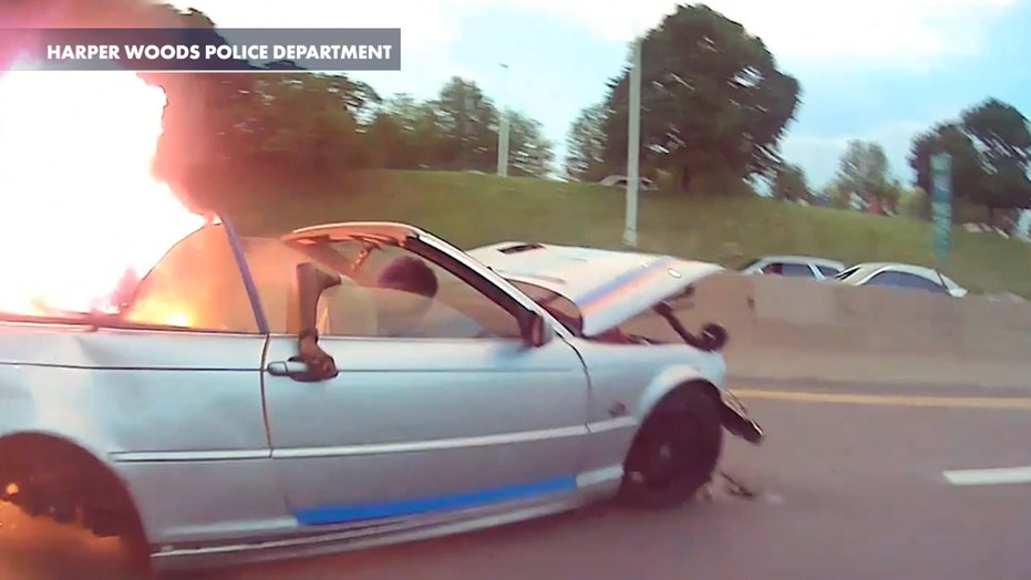 Michigan police officer pulls man from fiery crash