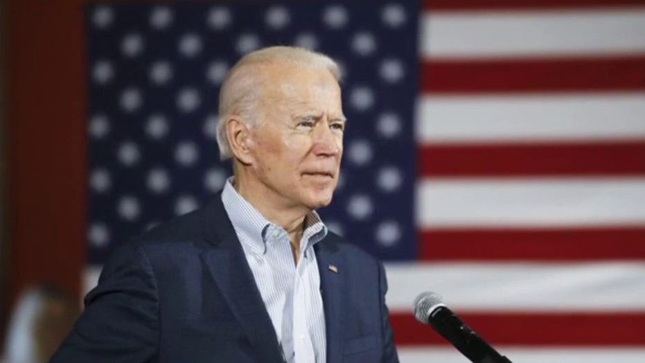 Biden slammed for coughing in his hand