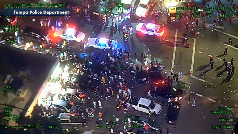 Crowd surrounds cops responding to reports of shots fired in Tampa
