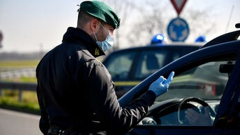 Northern Italy quarantines coronavirus-stricken towns as cases soar