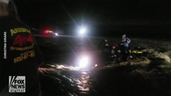 Dramatic video: Family of five and dog saved from flash flooding