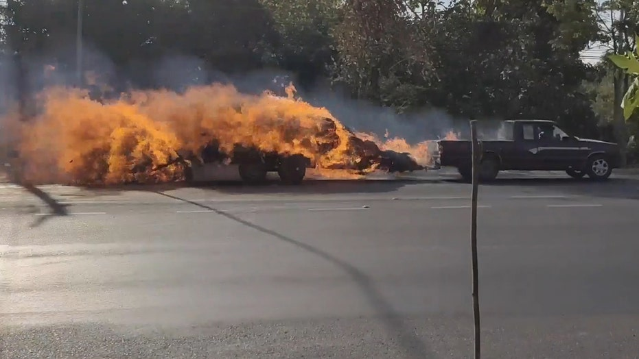See it: Truck towing flaming trailer speeds through town