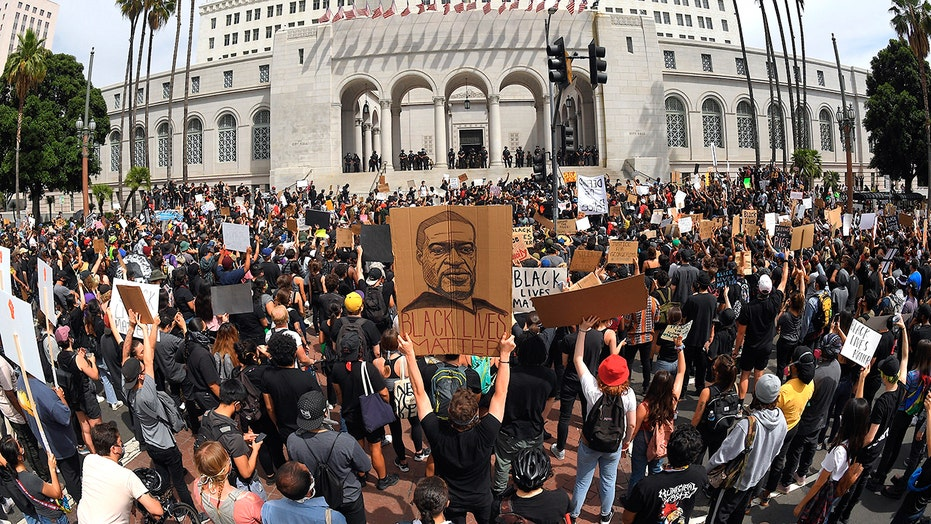 Thousands protest peacefully in Los Angeles as city council crafts police reform agenda