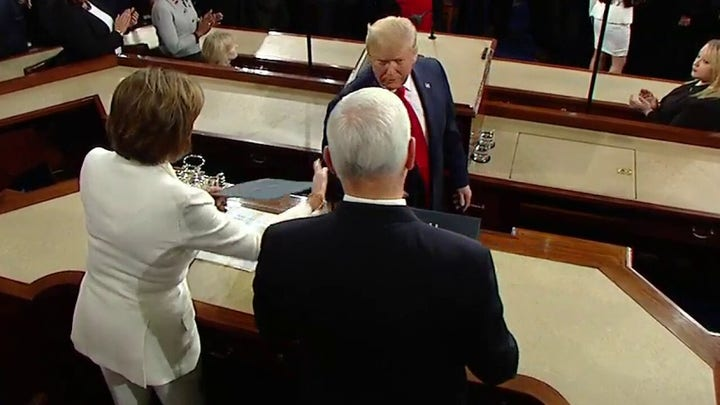 Handshake snub? President Trump appears to ignore Nancy Pelosi's outstretched hand at State of the Union