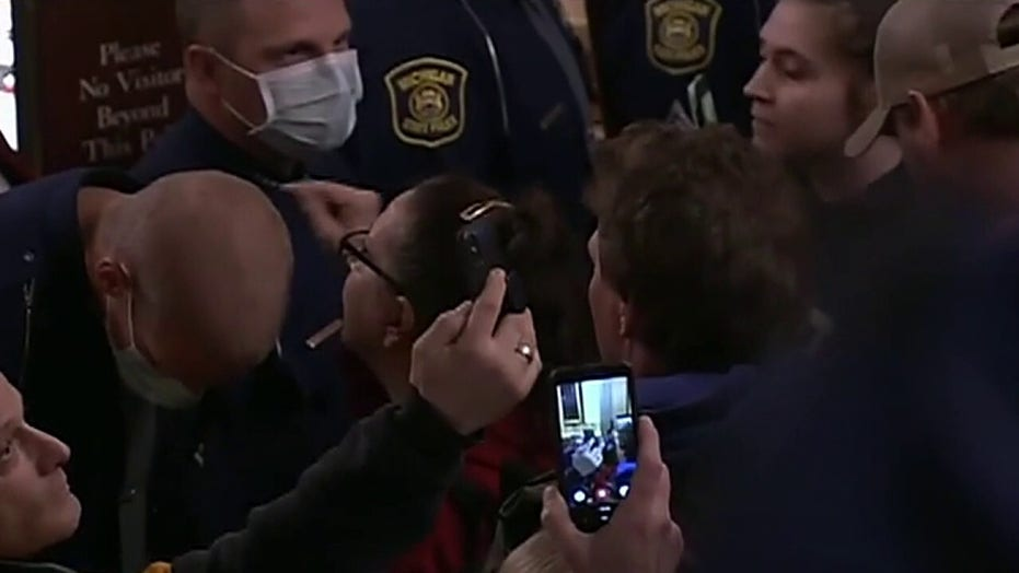 Armed protesters storm Michigan Capitol over stay-at-home orders