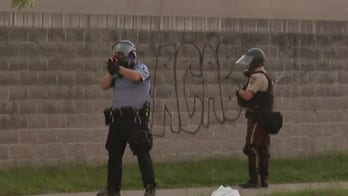 Law enforcement officer fires rubber bullet at man who refused to clear street in Minneapolis