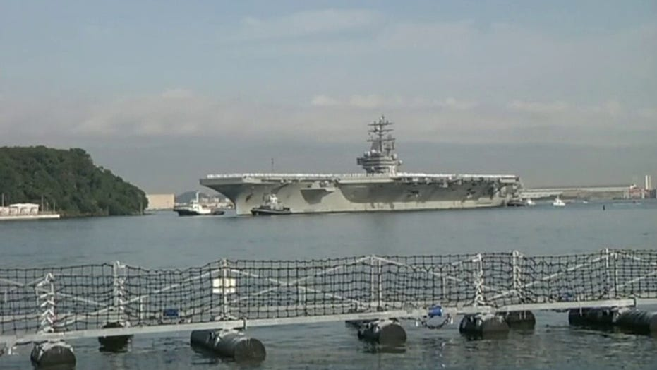 USS Theodore Roosevelt arrives in Guam after coronavirus outbreak on ship
