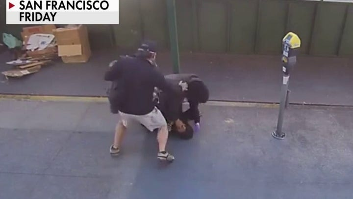 San Francisco police officer fends off attacker with help from bystander