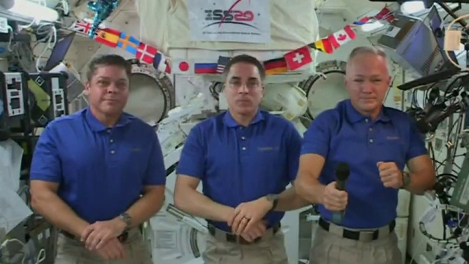 NASA astronauts halfway through mission aboard International Space Station