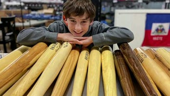 An Iowa boy is selling baseball bats from fallen trees to help storm victims