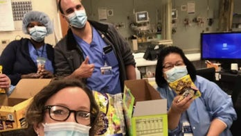 Nurse delivering snacks, coffee to fellow health care workers