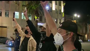 Thousands of protesters march in Los Angeles