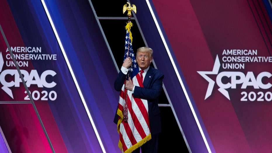 Trump fires up conservatives at CPAC by touting economy, blasting Democrats and Romney