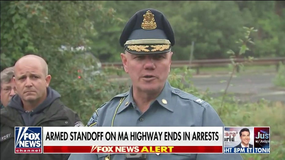 Massachusetts police arrest 11 men after standoff with armed group