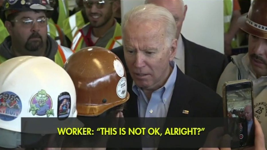 Joe Biden curses at Detroit voter during argument over gun control