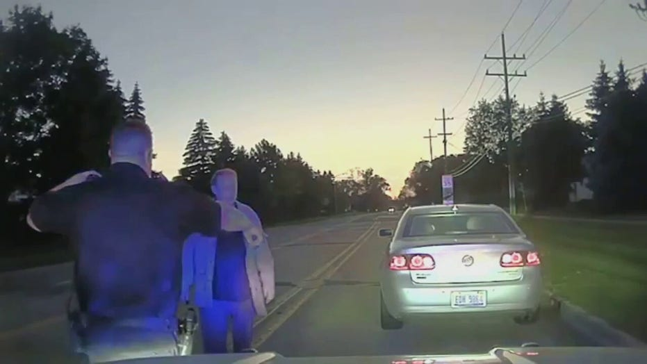 Michigan police help elderly man set up new TV after pulling him over for speeding: 'Outstanding job'