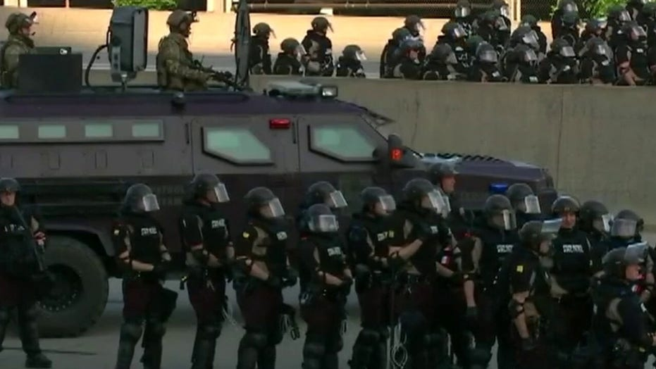Minneapolis city council votes on disbanding police, US cities consider defunding forces