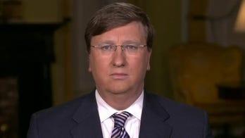 Mississippi governor explains decision to lift state's mask mandate