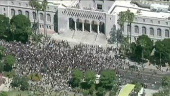 Thousands of peaceful demonstrators march through Los Angeles to protest George Floyd's death