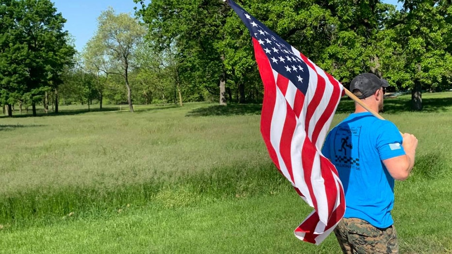 Man insists on running with American flag