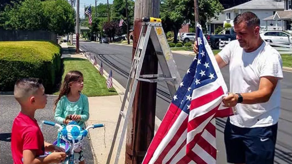 Community raises money to place hundreds of American flags throughout neighborhood