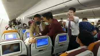 Thai Airways passenger forcibly restrained after intentionally coughing on crew member during delay: report