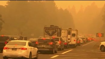 Death toll, evacuations rise from Western wildfires
