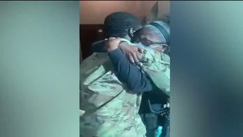 Military son comes home to surprise police sergeant mother for holidays