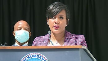 Atlanta mayor who tested positive for coronavirus faces backlash over earlier news conference without mask